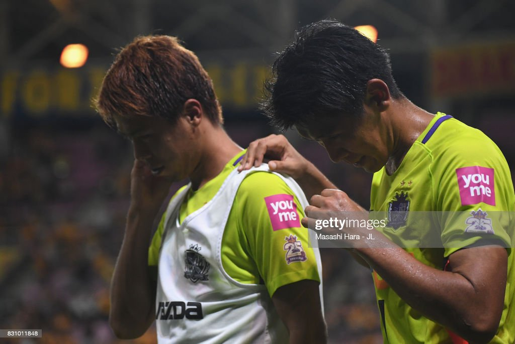 Daiki Niwa (R) and Takuya Marutani (L) of Sanfrecce Hiroshima show dejeciton after their 0-1 defeat in the J.League J1 match between Vegalta Sendai and Sanfrecce Hiroshima at Yurtex Stadium Sendai on August 13, 2017 in Sendai, Miyagi, Japan.