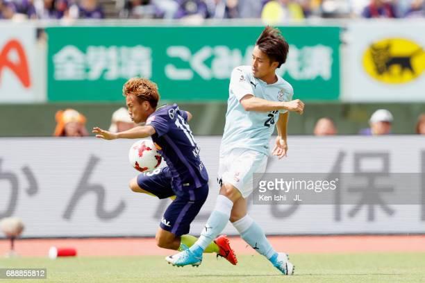 Daiki Ogawa of Jubilo Iwata and Yoshifumi Kashiwa of Sanfrecce Hiroshima compete for the ball during the JLeague J1 match between Sanfrecce Hiroshima...