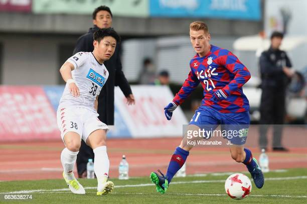 Daiki Suga of Consadole Sapporo and Oliver Bozanic of Ventforet Kofu compete for the ball during the JLeague J1 match between Ventforet Kofu and...