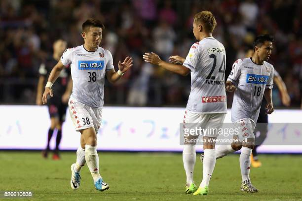 Daiki Suga of Consadole Sapporo celebrates scoring his side's first goal with his team mate Akito Fukumori during the JLeague J1 match between Cerezo...