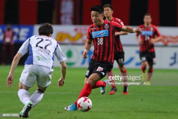 Daiki Suga of Consadole Sapporo takes on Oh Jae Suk of Gamba Osaka during the JLeague J1 match between Consadole Sapporo and Gamba Osaka at Sapporo...