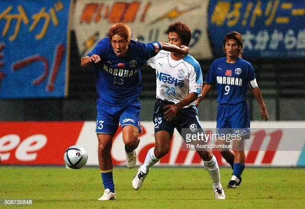 Daiki Takamatsu of Oita Trinita and Takashi Fukunishi of Jubilo Iwata compete for the ball during the JLeague match between Oita Trinita and Jubilo...