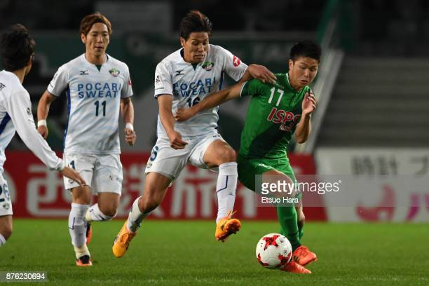 Daiki Watari of Tokushima Vortis and Tatsuya Uchida of Tokyo Verdy compete for the ball during the JLeague J2 match between Tokyo Verdy and Tokushima...