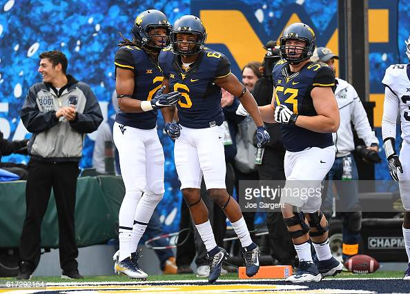 Daikiel Shorts celebrates his touchdown with Ka'Raun White of the West Virginia Mountaineers during the first quarter against the TCU Horned Frogs at...