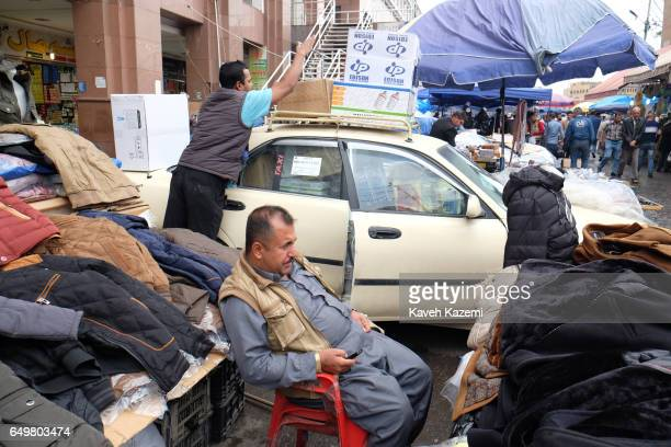 Daily activity in the market where clothing are on sale near the citadel on November 2 2016 in Erbil Iraq Erbil also spelt Arbil or Irbil is the...