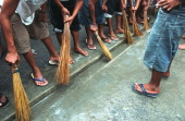 Daily cleaning of the cell floor at the barrack of Sputnik gang one of the four major gangs in Manila City Jail Manila City Jail was built for 800...