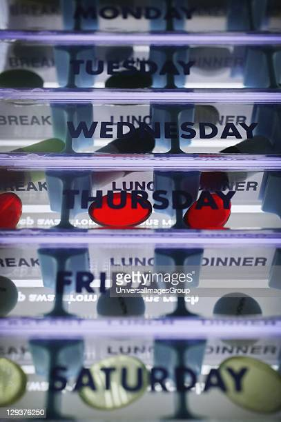 Daily doses pill box Daily doses pill box labeled with times of the day to remind the user when and what medication to take