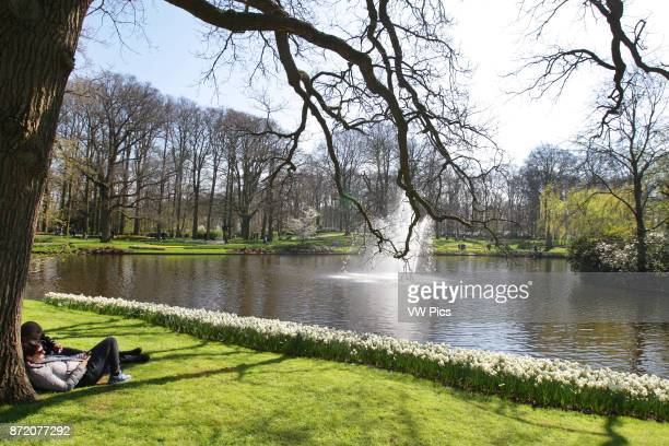 Daily Life A couple enjoying the view at Keukenhof Park on April 4 2017 in LisseNetherlands Keukenhof known as the Garden of Europe a spring park...