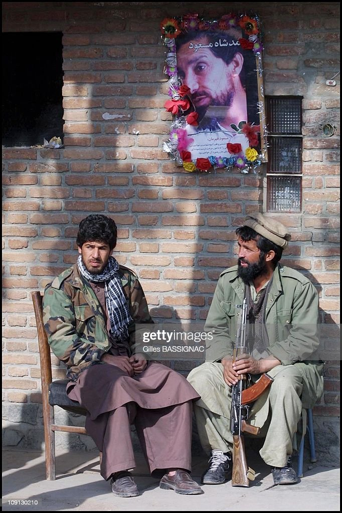 Daily Life In Kabul On May 12Th, 2001 In Kabul, Afghanistan. Mujaheddins In Charge Of One Of The Check Points Near Bagram, With Portraits Of Ahmed Shah Massoud On The Wall Behind Them.