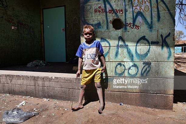 Daily life in one of the many Aboriginal town camps on the outskirts of Alice Springs in the Northern Territory A young Aboriginal boy outside of his...