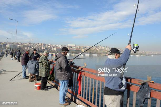 Daily life in the city of Istanbul Fishermen on the Galata Bridge which links the Golden Horn to the Eastern bank of the Bosphorus strait in Istanbul...