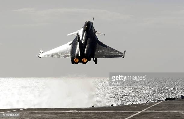 Daily life onboard the French Navy nuclearpowered aircraft carrier 'Charles de Gaulle' Takeoff of a Rafaletype fighter aircraft on the warship's...