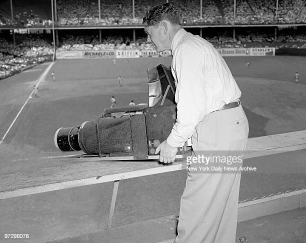 Daily News photographer Charles Hoff uses the Big Bertha camera at Yankee Stadium