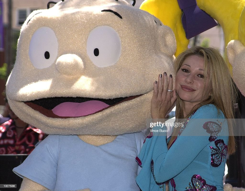 E.G. Daily, right, the voice of 'Rugrats' character Tommy, poses with a 'Rugrat' at a ceremony honoring the popular animated children''s show 'Rugrats' with a star on the Hollywood Walk Of Fame June 28, 2001 in Hollywood, CA.