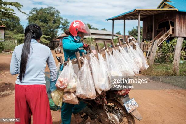 A daily scene of local people trading in Srekor village which will be affected by the flooding of the Lower Sesan II Dam Local communities refuse to...