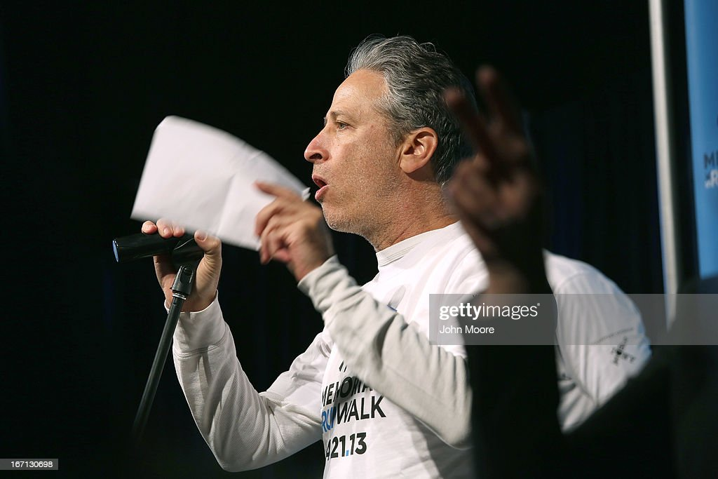 Daily Show host <a gi-track='captionPersonalityLinkClicked' href=/galleries/search?phrase=Jon+Stewart+-+Political+Satirist&family=editorial&specificpeople=202151 ng-click='$event.stopPropagation()'>Jon Stewart</a> addresses runners ahead of the 9/11 Memorial 5K Run/Walk on April 21, 2013 in New York City. Security was tight for the race, as has been the case in large scale events around the country since the Boston Marathon bombings. April 21 marks the anniversary that President Barack Obama signed into law legislation making 9/11 a day of service and volunteerism in memory of the victims of the 2001 attacks.