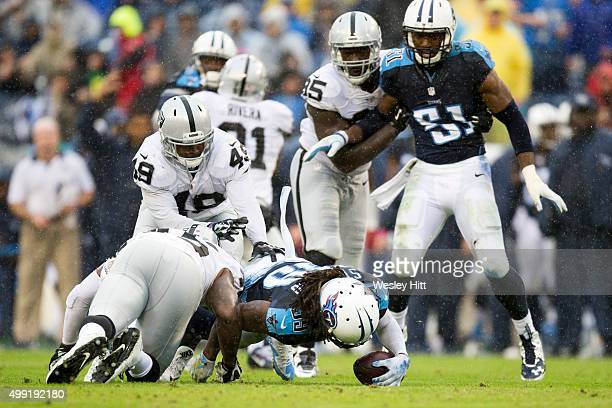 Daimion Stafford of the Tennessee Titans recovers a fumble during a game against the Oakland Raiders at Nissan Stadium on November 29 2015 in...