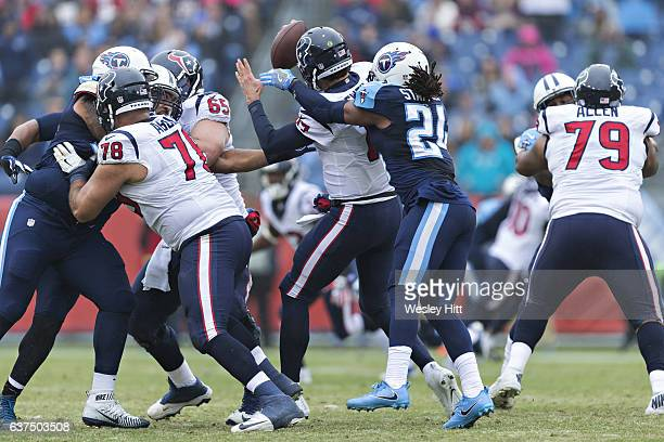 Daimion Stafford of the Tennessee Titans sacks Brock Osweiler of the Houston Texans at Nissan Stadium on January 1 2017 in Nashville Tennessee The...
