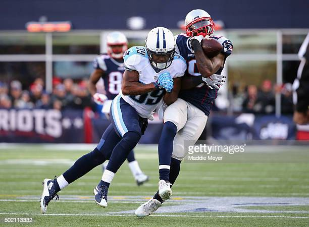 Daimion Stafford of the Tennessee Titans tackles Brandon LaFell of the New England Patriots at Gillette Stadium on December 20 2015 in Foxboro...