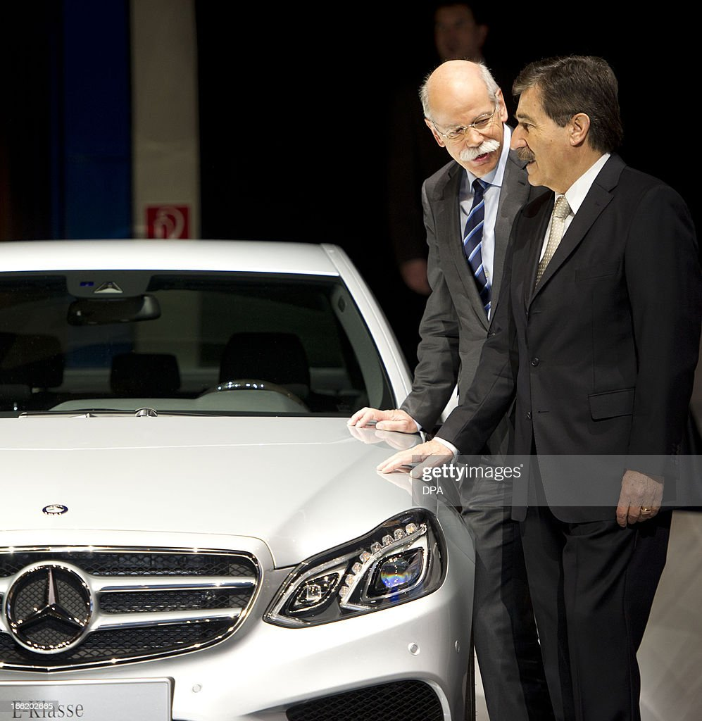 Daimler AG CEO and Chairman of the management board, Dieter Zetsche (L) and chairman of the supervisory board Manfred Bischoff are pictured next to a Mercedes E-Class during the company's annual general meeting in Berlin, Germany, on April 10, 2013. The chief of German carmaker Daimler said on April 10, 2013 that European demand had been weaker than expected in early 2013 and paved the way for a possible lowering of the company's annual targets.