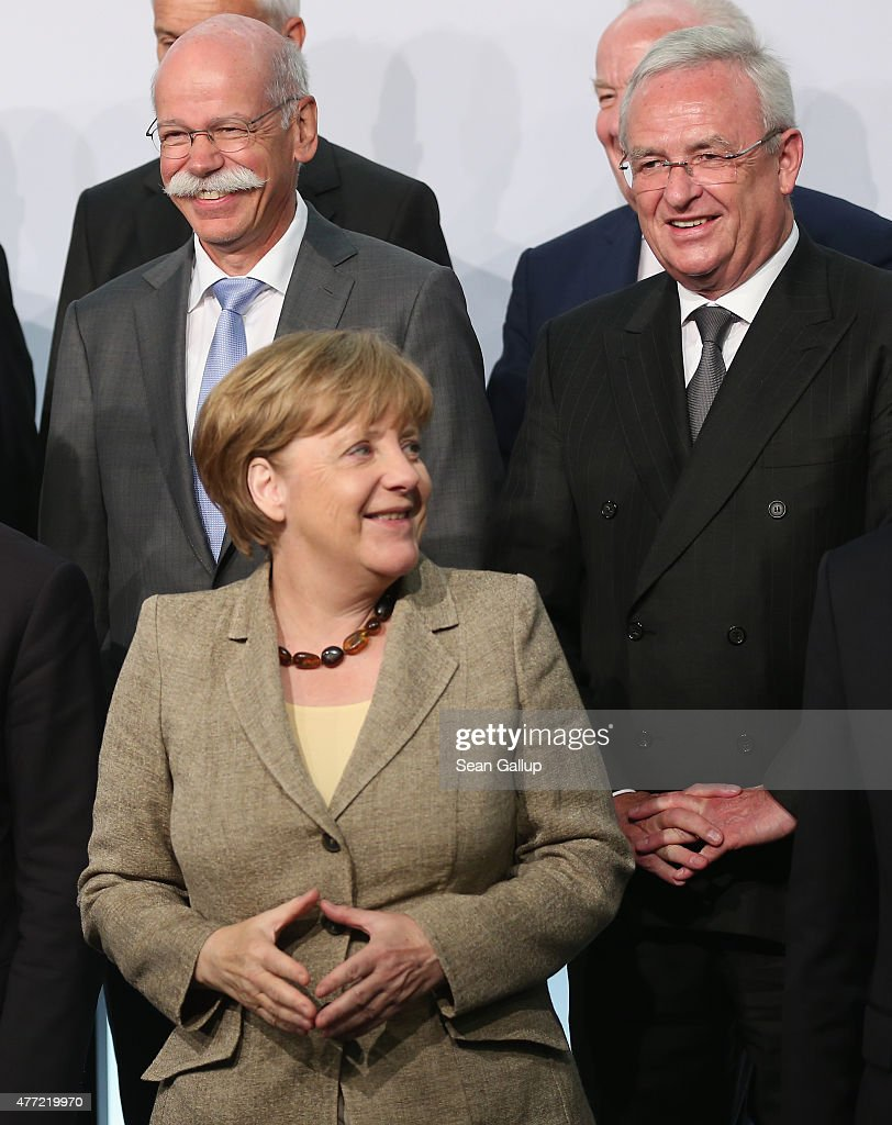 Daimler AG CEO Dieter Zetsche (2nd row, L) and Volkswagen Group CEO <a gi-track='captionPersonalityLinkClicked' href=/galleries/search?phrase=Martin+Winterkorn&family=editorial&specificpeople=840091 ng-click='$event.stopPropagation()'>Martin Winterkorn</a> (R) look on as German Chancellor <a gi-track='captionPersonalityLinkClicked' href=/galleries/search?phrase=Angela+Merkel&family=editorial&specificpeople=202161 ng-click='$event.stopPropagation()'>Angela Merkel</a> arrives at the government-sponsored electro-mobility conference on June 15, 2015 in Berlin, Germany. Top representatives of German and industry and government officials are meeting to discuss the future of electric-powered transport in Germany.