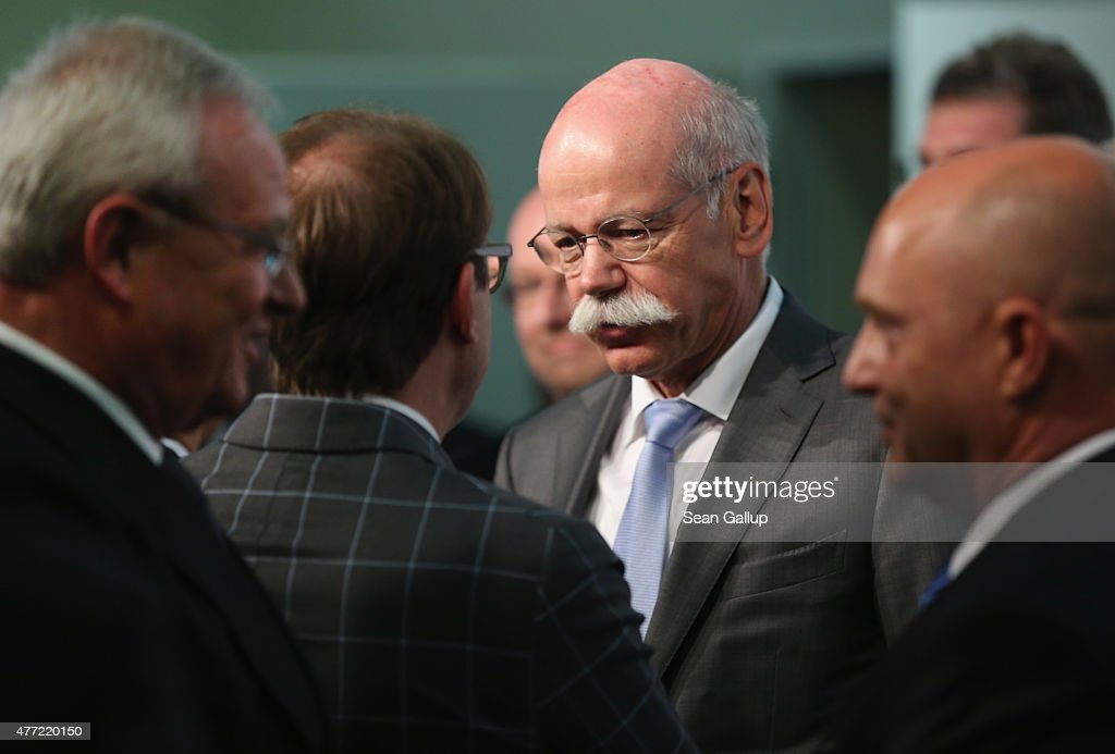 Daimler AG CEO <a gi-track='captionPersonalityLinkClicked' href=/galleries/search?phrase=Dieter+Zetsche&family=editorial&specificpeople=241297 ng-click='$event.stopPropagation()'>Dieter Zetsche</a> (C) chats with German Transport Minister <a gi-track='captionPersonalityLinkClicked' href=/galleries/search?phrase=Alexander+Dobrindt&family=editorial&specificpeople=5702301 ng-click='$event.stopPropagation()'>Alexander Dobrindt</a> as Volkswagen Group CEO <a gi-track='captionPersonalityLinkClicked' href=/galleries/search?phrase=Martin+Winterkorn&family=editorial&specificpeople=840091 ng-click='$event.stopPropagation()'>Martin Winterkorn</a> (L) arrives at the government-sponsored electro-mobility conference on June 15, 2015 in Berlin, Germany. Top representatives of German and industry and government officials are meeting to discuss the future of electric-powered transport in Germany.