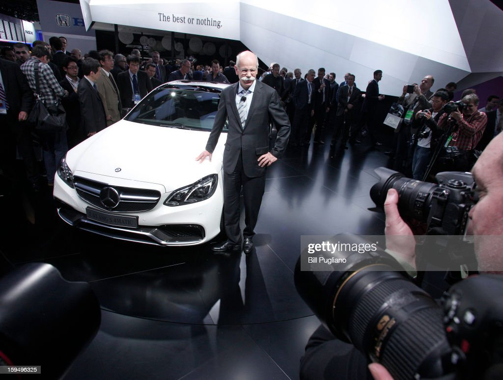Daimler AG Chairman and CEO Dieter Zetsche poses with the new 2014 Mercedes-Benz E63 AMG at its world debut at the 2013 North American International Auto Show media preview at the Cobo Center January 14, 2013 in Detroit, Michigan. Approximately 6,000 members of the media from 68 countries are attending the show this year. The 2013 NAIAS opens to the public January 19th.