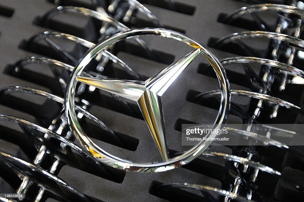 Daimler AG MercedesBenz emblems stand ready for attachment to the new AClass MercedesBenz passenger car at the MercedesBenz factory on July 16 2012...