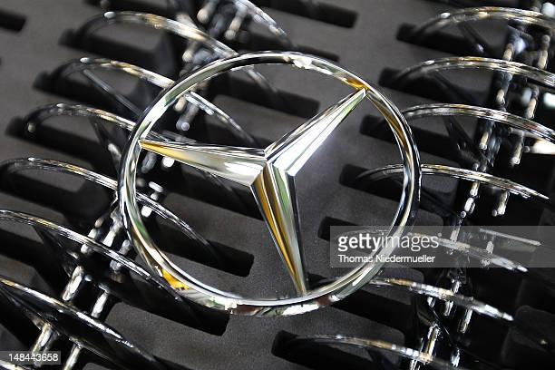 Daimler AG MercedesBenz emblems stand ready for attachment to the new AClass MercedesBenz passenger car at the MercedesBenz factory on July 16 2012...