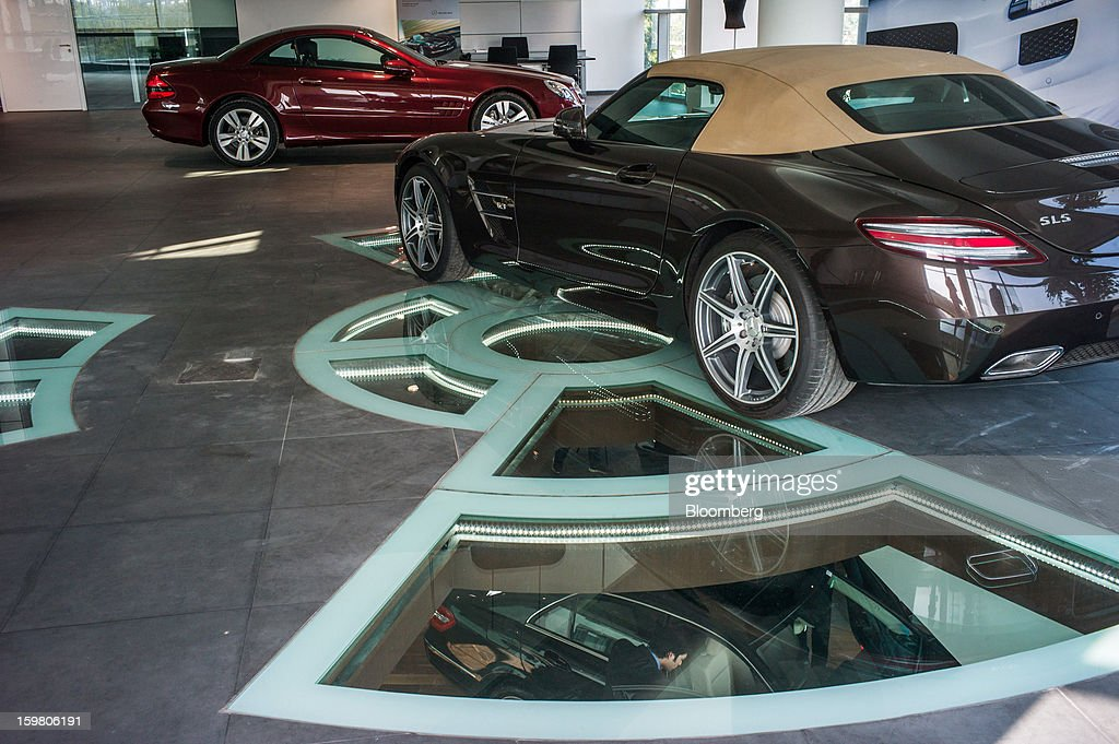 A Daimler AG Mercedes-Benz SLS AMG Roadster vehicle sits on display inside the newly opened T&T Motors Ltd. Mercedes-Benz India flagship dealership in New Delhi, India, on Saturday, Jan. 19, 2013. The Indian Finance Ministry projects Asia's third-largest economy will expand as little as 5.7 percent in the 12 months to March 31, which would be the weakest pace in a decade. Photographer: Sanjit Das/Bloomberg via Getty Images