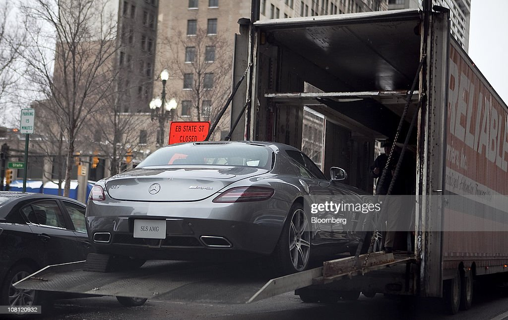 A Daimler AG Mercedes-Benz SLS AMG sports car is loaded onto a truck after being displayed during a preview event for the North American International Auto Show (NAIAS) in Detroit, Michigan, U.S., on Wednesday, Jan. 12, 2011. The 2011 Detroit auto show runs through Jan. 23 and features more than 30 new vehicle premieres. Photographer: Keyur Khamar/Bloomberg via Getty Images
