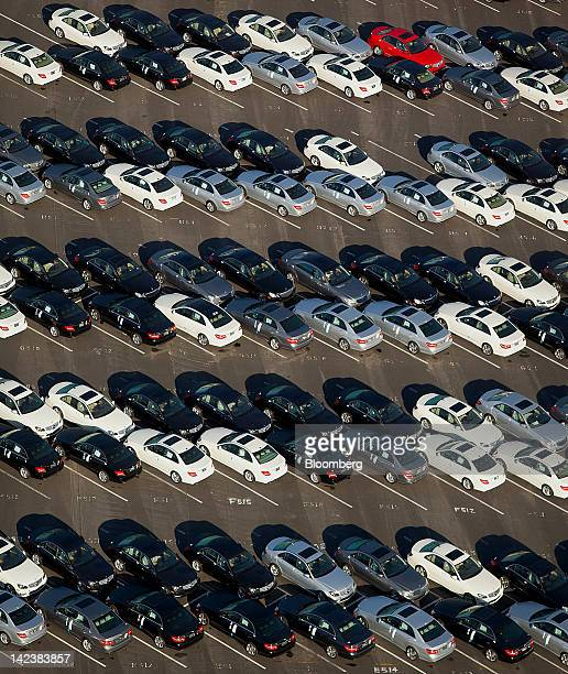Daimler AG MercedesBenz vehicles sit lined up for dealer delivery at a distributuon center outside the Port of Long Beach in Long Beach California US...