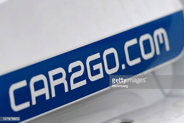 Daimler AG's Car2go logo sits on a new Smart micro hybrid drive vehicle at a dealership in Ulm Germany on Monday Jan 10 2011 Daimler's Car2go service...