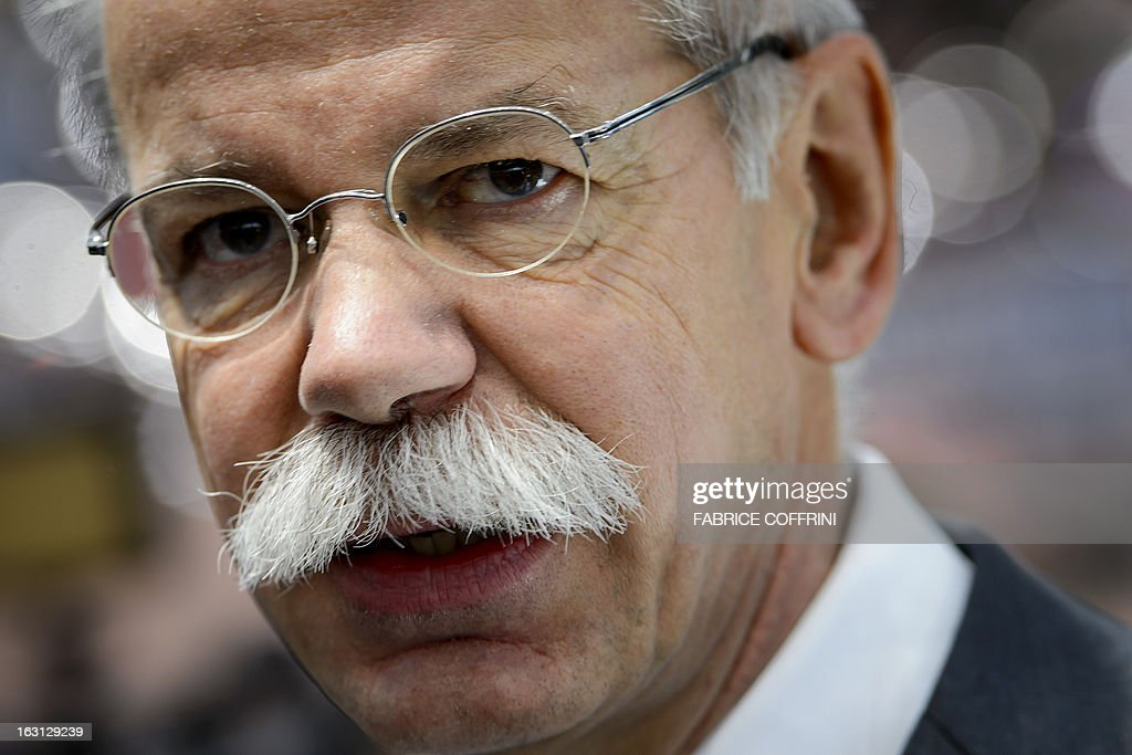 Daimler CEO Dieter Zetsche looks on at the Mercedes Benz car maker's booth on March 5, 2013 on the press day of the Geneva car Show in Geneva. The Geneva International Motor Show opened its doors to the press under a dark cloud, with no sign of a speedy rebound in sight for the troubled European market. The event, which is considered one of the most important car shows of the year, will again be heavily marked by the crisis in Europe after an already catastrophic year in 2012.
