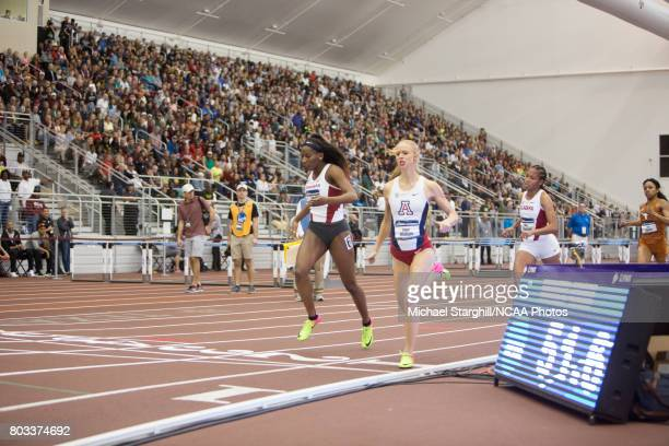 Daina Harper of Arkansas and Sage Watson of Arizona compete in the women's 400 meter dash during the Division I Men's and Women's Indoor Track Field...