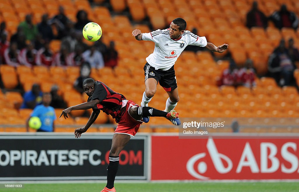 Daine Klate of Orlando pirates battling for the ball with Mwelwa Sakala of Zanaco FC during the CAF Confedaration Cup match between Orlando Pirates and Zanaco at FNB Stadium on April 06, 2013 in Johannesburg, South Africa.