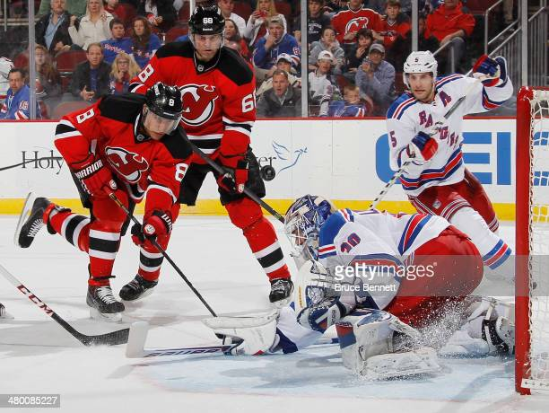 Dainius Zubrus and Jaromir Jagr of the New Jersey Devils are stopped by Henrik Lundqvist of the New York Rangers during the second period at the...