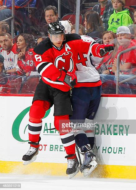 Dainius Zubrus of the New Jersey Devils and John Carlson of the Washington Capitals come together at the boards during the game at the Prudential...