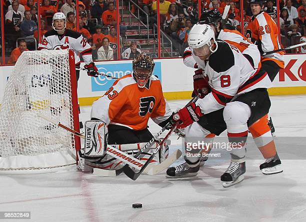 Dainius Zubrus of the New Jersey Devils looks to control a rebound off Brian Boucher of the Philadelphia Flyers in Game Three of the Eastern...