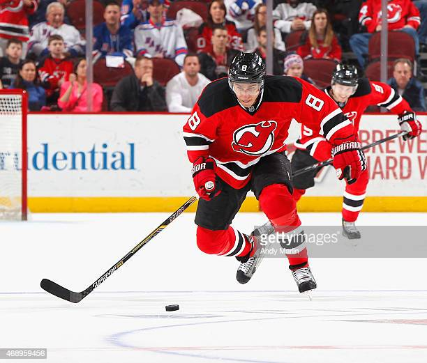 Dainius Zubrus of the New Jersey Devils plays the puck during the game against the New York Rangers at the Prudential Center on April 7 2015 in...