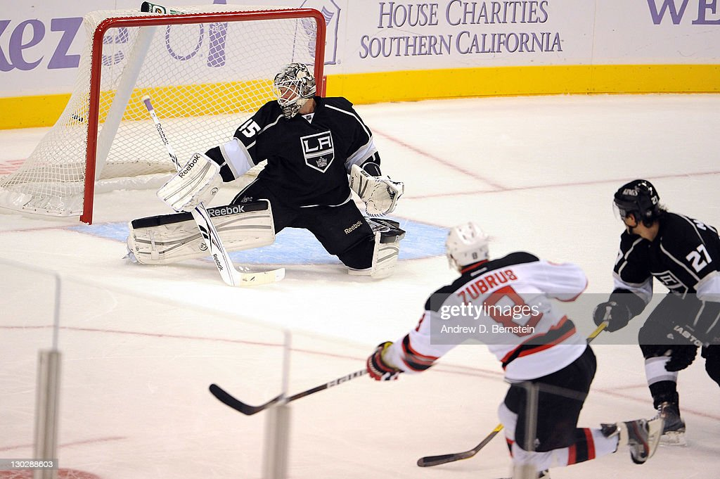 Dainius Zubrus #8 of the New Jersey Devils shoots and scores a goal against <a gi-track='captionPersonalityLinkClicked' href=/galleries/search?phrase=Jonathan+Bernier&family=editorial&specificpeople=540491 ng-click='$event.stopPropagation()'>Jonathan Bernier</a> #45 of the Los Angeles Kings at Staples Center on October 25, 2011 in Los Angeles, California.