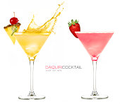Daiquiri frozen cocktails with one splashing out and garnished with fresh fruit, isolated on white background. Design template with sample text