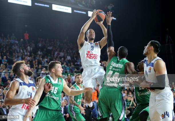 Dairis Bertans and Marcus Slaughter of Darussafaka Dogus in action againstAnthony Randolph of Real Madrid during the Turkish Airlines EuroLeague...