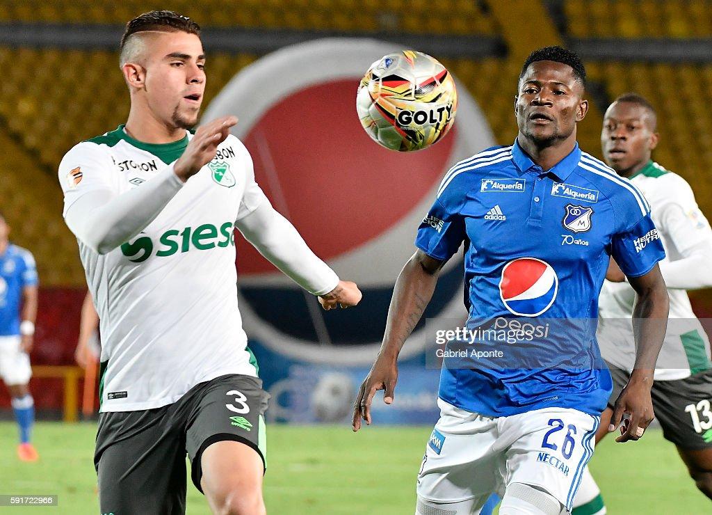 Dairon Asprilla of Millonarios struggles for the ball with Juan Quintero of Cali during a match between Millonarios and Deportivo Cali as part of...