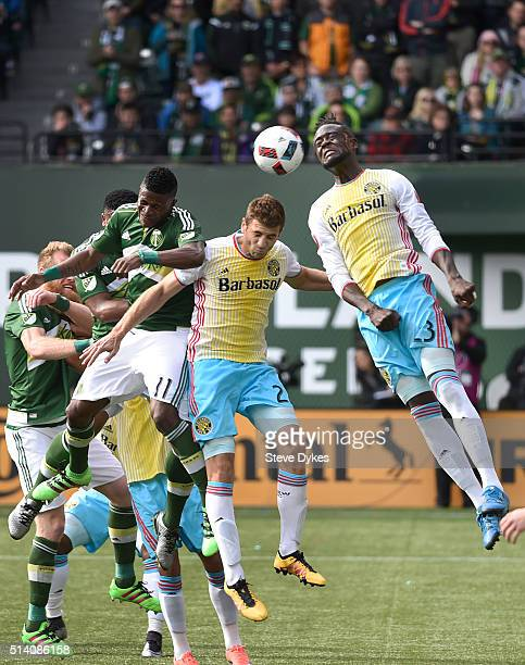 Dairon Asprilla of Portland Timbers Gaston Sauro of Columbus Crew and Kei Kamara of Columbus Crew go up for a ball during the first half of the game...