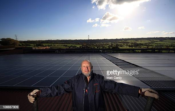 Dairy farmer and founder of the Glastonbury Music Festival Glastonbury Michael Eavis stands in front of the new Worthy Farm's new solar photovoltaic...