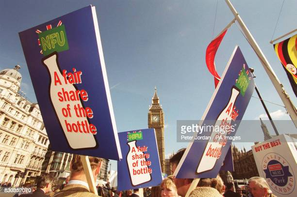 Dairy farmers outside the Houses of Parliament in London as part of the National Farmers Union's Fair Share of the Bottle campaign over plummeting...