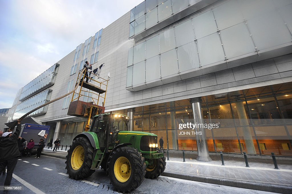 Dairy farmers stage a protest against EU agricultural policies at the Place du Luxembourg, near the European Parliament, in Brussels, on November 26, 2012. Farmers demonstrated today with their tractors and fake cows at the European Parliament in Brussels to protest against falling milk prices caused by overproduction in Europe.