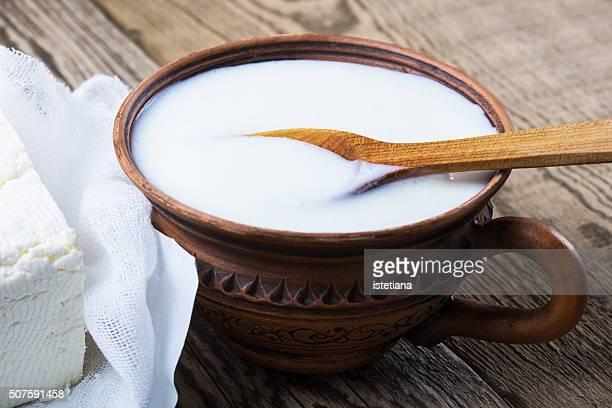 Dairy products. Healthy  yogurt in ceramic mug on wooden background