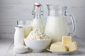 Dairy products on white wooden table